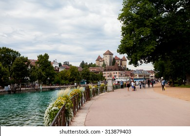 ANNECY, FRANCE, 23 AUGUST 2015 - The town of Annecy daytime, busy with people, walking, boat sailing and other activities. Annecy is known to be called the French Venice
