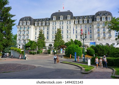 ANNECY, FRANCE -24 JUN 2019- View of the Imperial Palace, a landmark Belle Epoque grand hotel on the Annecy Lake in Annecy, Haute Savoie, France.