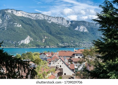 ANNECY, FRANCE - 28 SEPTEMBER 2019: roof top view over Old town Annecy. Lake Annecy and the Alps mountains in the background.
