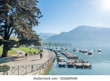 ANNECY, FRANCE - APRIL 14 : Boats dock in lake with mountain view in background in Annecy, France, on April 14, 2017.