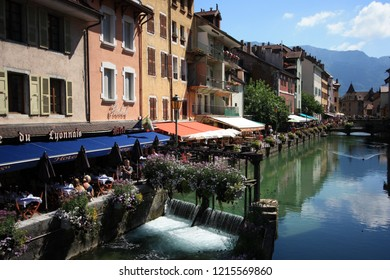 Annecy, France - August 10th 2013: Old Watergate separating the Thiou river in Annecy's scenic old city center