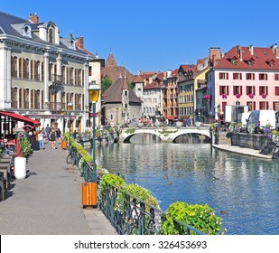 ANNECY, FRANCE - AUGUST 22, 2015: View of the street in city centre of Annecy on August 22, 2015. Annecy is a capital of Haute Savoie province, France.