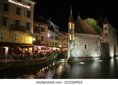 Annecy, France - August 9th 2013: Night view of the Palais de l'Isle and the Thiou river in Annecy