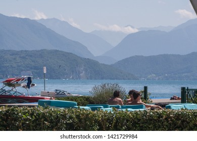 Annecy, France - Augustus 21, 2008: Magnificant view, mountains, lake, seats, cushions on the municipal beach in Annecy
