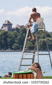 Annecy, France - Augustus 21, 2008: a Lifeguard in a high chair overlooking the plage munipale / city beach