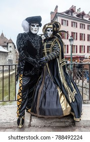 Annecy, France, February 23, 2013: Disguised couple posing in Annecy, France, during a Venetian Carnival which celebrates the beauty of the real Venice.