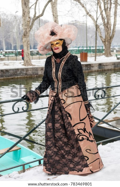 Annecy, France, February 23, 2013: Image of a disguised person posing in Annecy, France, during a Venetian Carnival which celebrates the beauty of the real Venice.