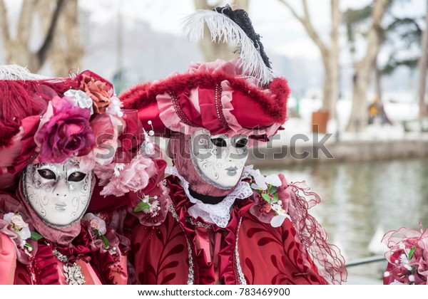 Annecy, France, February 23, 2013: Portrait of a disguised couple posing in Annecy, France, during a Venetian Carnival which celebrates the beauty of the real Venice.