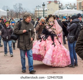 ANNECY, FRANCE - FEBRUARY 23: Crowds and photographers taking pictures of the participants at the 17th Edition of the Annual Carnival Venitian d' Annecy on February 23,2013 in Annecy, France.