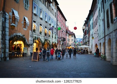 ANNECY, FRANCE - January 2016: The people crowd walking on the streets of Annecy at Christmas ave in Annecy, France