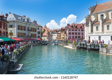 Annecy, France - July 15, 2018: Cityscape in the sunny city Annecy with canal,on old colorful buildings.