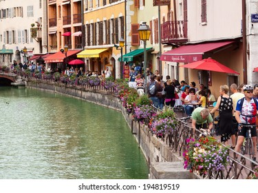 ANNECY, FRANCE - JULY 15: People walk on the Quai de l'Isle in the center of old district on July 15, 2012 in Annecy, France. Annecy is one of the most beautiful and old towns in France.