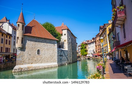 Annecy, France - July 2019 : The Palais de l'Isle on an island in the river Thiou in Annecy. It mostly served as a prison and courthouse until the French Revolution