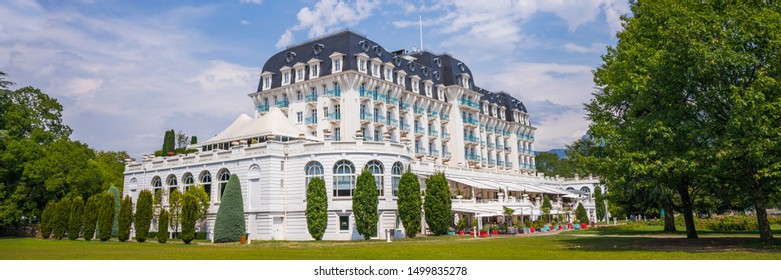 Annecy, France - July 2019 : Panoramic view of the Imperial Palace is a four-star hotel located on the shores of Lake Annecy