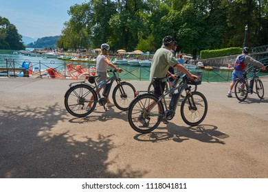 ANNECY, FRANCE - JUNE 16, 2018 : friends cycling around the Annecy lake