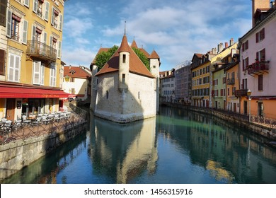 "Annecy, France - June 16, 2019: The ""Palais de l'Ile"" in Annecy, a historical building placed on a small island of the river Thiou. The building was a prison in the past, now it's a museum"