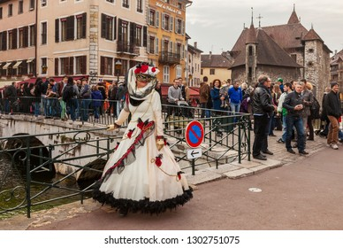 Annecy, France, March 15, 2014:  Image of a disguised person, posing on a bridge in Annecy, France, during a Venetian Carnival which celebrates the beauty of the real Venice.