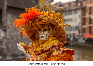 Annecy, France, March 15, 2014:  Portrait of a disguised person, posing in Annecy, France, during a Venetian Carnival which celebrates the beauty of the real Venice.