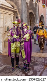 Annecy, France, March 15, 2014:  Portrait of a disguised couple, posing in Annecy, France, during a Venetian Carnival which celebrates the beauty of the real Venice.