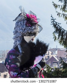 Annecy, France, March 16, 2014:  Portrait of a disguised person, posing in Annecy, France, during a Venetian Carnival which celebrates the beauty of the real Venice.