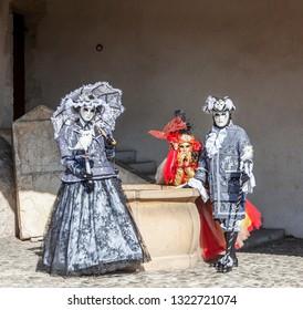 Annecy, France, March 16, 2014:  Portrait of three disguised people, posing in Annecy, France, during a Venetian Carnival which celebrates the beauty of the real Venice.