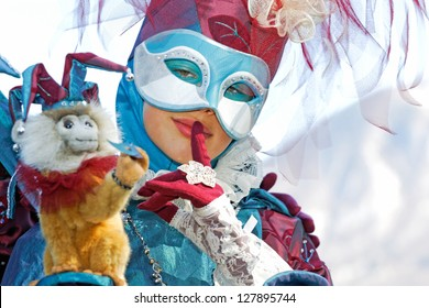 ANNECY, FRANCE - MARCH 3: Unidentified woman dressed in Venetian costume, March 3, 2012 in Annecy, France. 350 people in costume participate rivaling the festival in Venice in size.