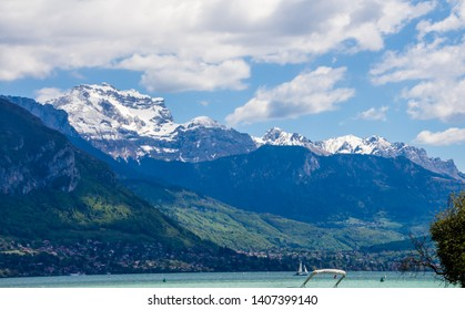 "Annecy, France - May 12, 2019: Picturesque Alpine town in southeastern France, aka the""Pearl of French Alps""  or  ""Venice of the Alps"", located between lake Annecy, mountains  and the Thiou river"