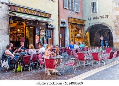 """ANNECY, FRANCE- MAY 16:  Unknown group of people are having their lunch in a cafe in the city center on May 16, 2017 in ANNECY. The city was nicknamed the """"Pearl of French Alps"""""""