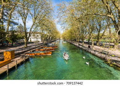 Annecy, France - May 25, 2016: View of river and boats from Pont des Amours (Bridge of Love) in Annecy, France. Annecy is a commune in the Haute Savoie department of the Rhone-Alpes region in France.