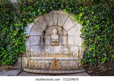 Annecy, France - May 25, 2016: Stone bust of Jean-Jacques Rousseau in a niche with a fountain in Annecy, France. Jean-Jacques Rousseau was a philosopher, writer, and composer of the 18th century.