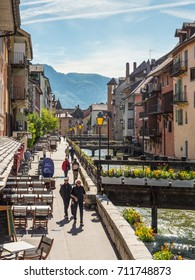 Annecy, France - May 25, 2016: People walking along river Thiou in city centre of Annecy, capital of Haute Savoie province in France. Annecy is known to be called the French Venice.
