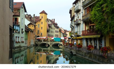 Annecy, France - May 9. 2016: View over river on bridge with market in historic city center (focus on bridge)
