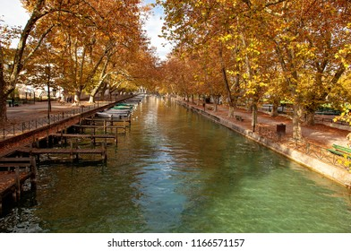 Annecy, France - October 21, 2017: view to the Annecy lake and channel with boats in autumn