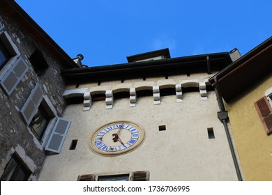 Annecy / France - October 5, 2019:  Opening the way to Chambéry through the St Claire Faubourg, the St. Claire Gate (Porte Sainte Claire) with the clock tower, Place Sainte Claire in Old Town.