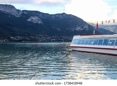 Annecy / France - October 5, 2019: Passenger cruise ship moored on Annecy lake. Annecy Lake is one of most popular French resorts.