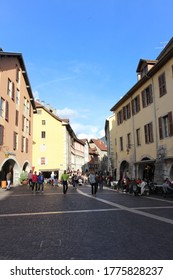 Annecy / France - October 5, 2019:  Arcaded houses and colourful facades, café terrace and shops of the Sainte-Claire street.