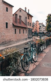 Annecy / France - October 5, 2019: Old bicycle parked near the Palais de l'Ile on the old town. The Palace has been a prison, a courthouse and an administrative centre.