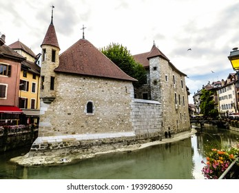 """Annecy,  France - October 5, 2019: The Chapel of the Palais de l'Ile. The Palace, often described as a """"house in the shape of a ship"""" has been a prison, a courthouse and an administrative centre."""