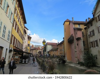 Annecy, France - October 5, 2019: Quai de l'Evêché street and bridge Pont Morens. Pont Morens is Annecy's first stone bridge. It was covered by houses until the 19th century. The house of Charmoisy.