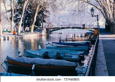 Annecy france pont des amours bridge of love in winter with boat