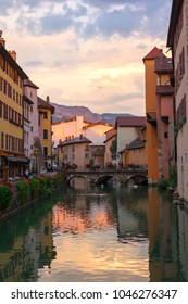 ANNECY, FRANCE - SEPTEMBER 2016: Beautiful cityscape of Annecy, called touristically the Venice of Savoie. The medieval town center built around a 14th Century Chateau is dissected by small canals