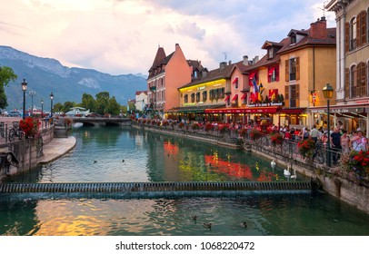 ANNECY, FRANCE - SEPTEMBER 2016: Looking along Le Thiou river in Annecy France at late evening. The area has many bars, restaurants and cafes and is a very popular tourist attraction.