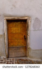 ANNECY, France - September 7 2018:  An old wooden door near Chateau d'Annecy. Located in the Auvergne-Rhône-Alpes region in southeastern France, Annecy is often called the Venice of the Alps