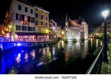 annecy french alps haute savoie old jail prison by night in winter with swan christmas time
