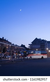 ANNECY, HAUTE SAVOIE / FRANCE August 15 2018: Annecy bus station, the last bus of the Annecy-Geneva line arrives at nightfall and under the crescent moon in August