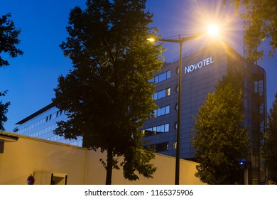 ANNECY, HAUTE SAVOIE / FRANCE August 08 2018: at nightfall, the station area, the Novotel and its tower under the blue electric sky and urban lighting