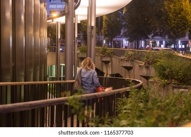 ANNECY, HAUTE SAVOIE / FRANCE AUGUST 15 2018:  in front of Annecy station, a woman is in a hurry to return home because the night falls