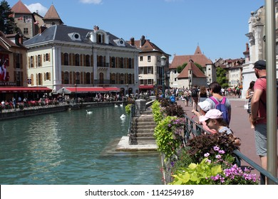 ANNECY, HAUTE SAVOIE / FRANCE JUILY 22 2018: beginning of the old town from the lake and the gardens of Europe, parents and children enjoy this beautiful sunny day