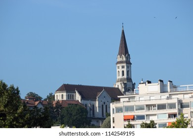 ANNECY, HAUTE SAVOIE / FRANCE JUILY 22 2018: telephoto view of the basilica of the visitation in the early morning from the thiou quays
