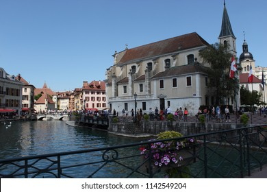 ANNECY, HAUTE SAVOIE / FRANCE JUILY 22 2018: The church st francois de sales from the bridge at the beginning of the old town, the sun illuminates the background